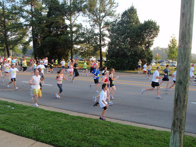 Cheering on Ellie (in the tutu) at the start of her 7AM race