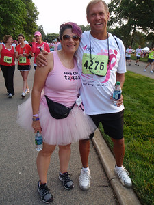 Dennis with Ellie in her tutu (running for her tatas!)