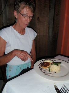Becky explaining that the drizzle on her crab cakes is balsamic topping, not chocolate!