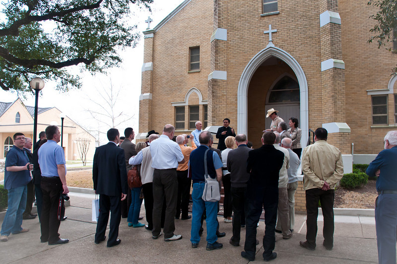 Fr. JoJo welcomes the delegates on the steps of the church.