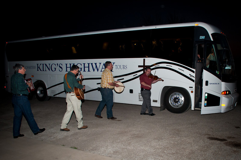 Brian Marshall and Polish musicians welcome the bus of delegates.