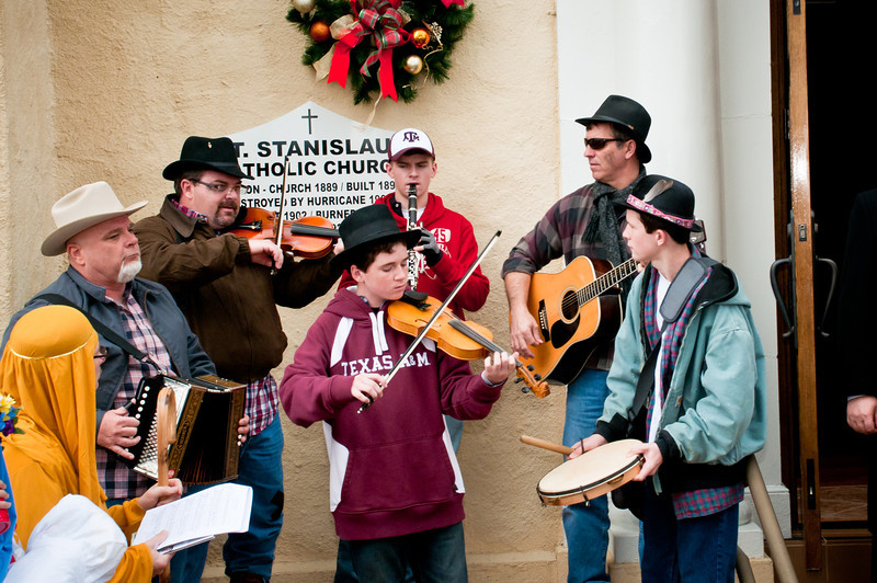 "Frank Motley playing with Brian Marshall and Ron Kasowski and their sons Michael Marshal, Jacob Marshall and Jake Kasowski on the steps of St. Stanislaus Catholic Church in Chappell Hill, Texas for ""Polskie Kolędy"" 2011."