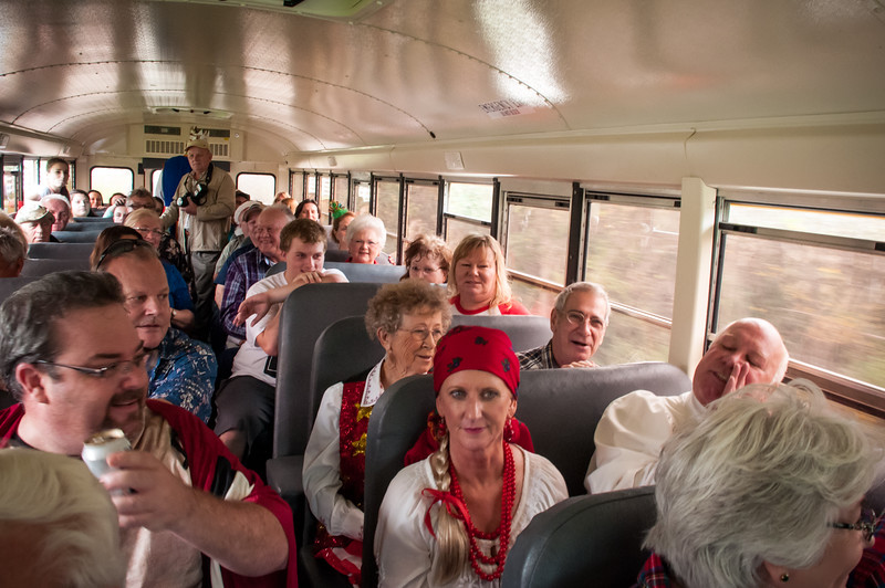 Fun on the big yellow bus with musicians and carolers