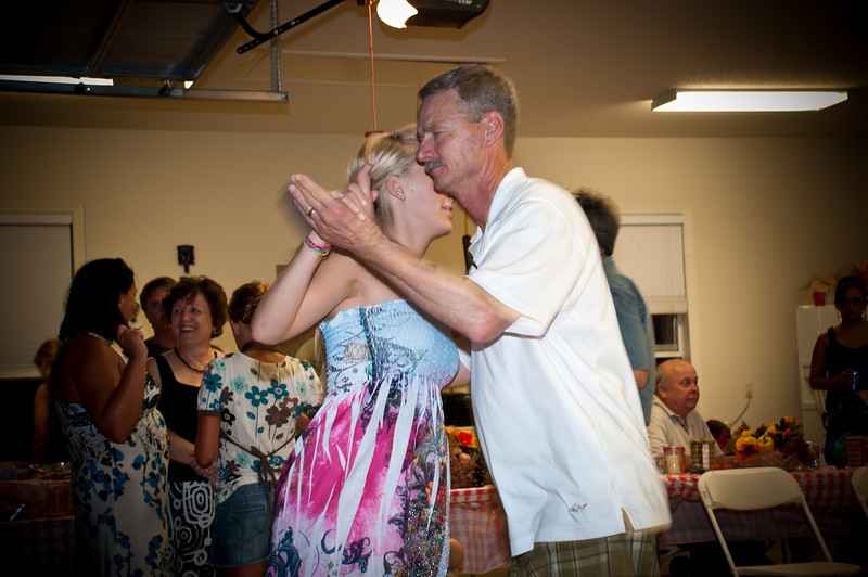 Dr. Jim dancing with his daughter