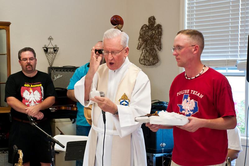 Monsignor John Malinowski blesses the home before the festivities start