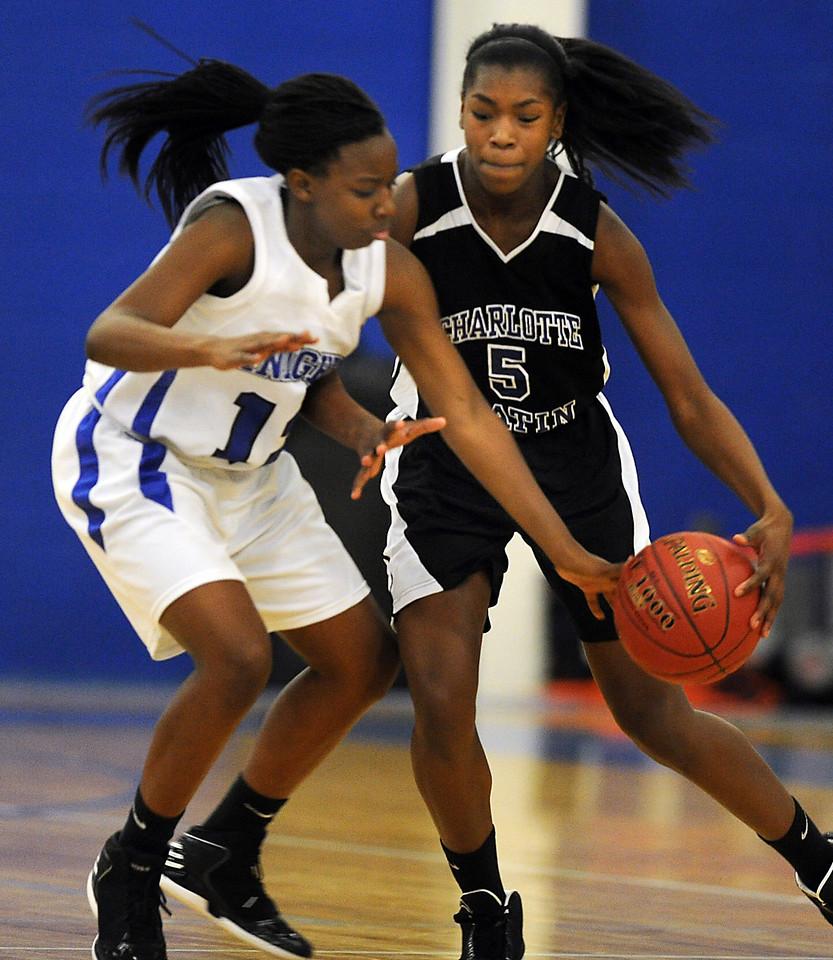 The St. Joseph's Knights played host to the Charlotte Latin Hawks in a rival basketball game.<br /> GWINN DAVIS PHOTOS<br /> gwinndavisphotos.com (website)<br /> (864) 915-0411 (cell)<br /> gwinndavis@gmail.com  (e-mail) <br /> Gwinn Davis (FaceBook)