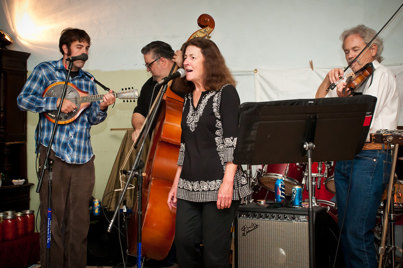 Documentary producer Joe Weed sits in with the band while his wife Marty sings