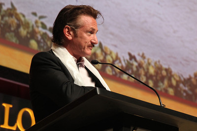 Sean Penn introduces the Dalai Lama as he prepares to give a public talk on Non-violence at Loyola University in Chicago, IL, USA on Thursday, April 26, 2012