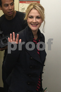 """Drew Barrymore signs the 7th Inning Stretch at the Cubs game at Wrigley Field. She is joined by the Windy City Rollers to promote her new movie """"Whip It"""". Chicago, IL USA 15 September, 2009"""