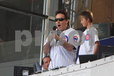 "John Cusack sings ""Take Me Out to the Ball Game"" during the 7th inning stretch of the Cubs Pirates game at Wrigley Field   in Chicago, IL USA 15 August, 2009"