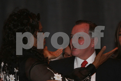 Oprah Winfrey hugs Chicago Mayor Richard Daley as Archbishop Desmond Tutu receives the Abraham Lincoln Presidential Library Foundation's Lincoln Leadership Prize at the Ritz Carlton in Chicago, IL, 13 May, 2008
