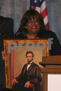 Chaz Ebert, wife of Roger Ebert, holds a portrait of Lincoln as Archbishop Desmond Tutu receives the Abraham Lincoln Presidential Library Foundation's Lincoln Leadership Prize, presented by Oprah Winfrey, at the Ritz Carlton in Chicago, IL, 13 May, 2008