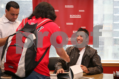 Oscar De La Hoya signs copies of his latest book American Son at Borders Bookstore in downtown Chicago on June 30, 2008. Alexandra Buxbaum/Retna