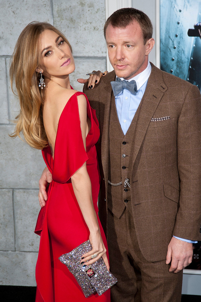 WESTWOOD, CA: Model Jacqui Ainsley and director Guy Ritchie arrive at the premiere of Warner Bros. Pictures' 'Sherlock Holmes: A Game Of Shadows' held at the Regency Village Theatre in Westwood, California. Photo taken on Tuesday, December 6, 2011 by Tom Sorensen/Moovieboy Pictures.