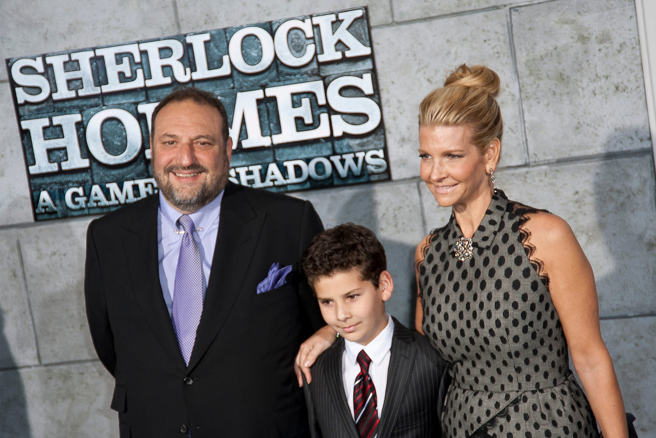 WESTWOOD, CA: Producer Joel Silver and wife Karyn Fields with their son arrive at the premiere of Warner Bros. Pictures' 'Sherlock Holmes: A Game Of Shadows' held at the Regency Village Theatre in Westwood, California. Photo taken on Tuesday, December 6, 2011 by Tom Sorensen/Moovieboy Pictures.