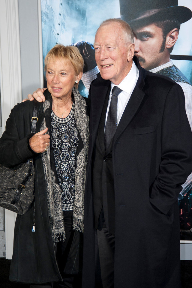 WESTWOOD, CA: Actor Max von Sydow and guest arrive at the premiere of Warner Bros. Pictures' 'Sherlock Holmes: A Game Of Shadows' held at the Regency Village Theatre in Westwood, California. Photo taken on Tuesday, December 6, 2011 by Tom Sorensen/Moovieboy Pictures.