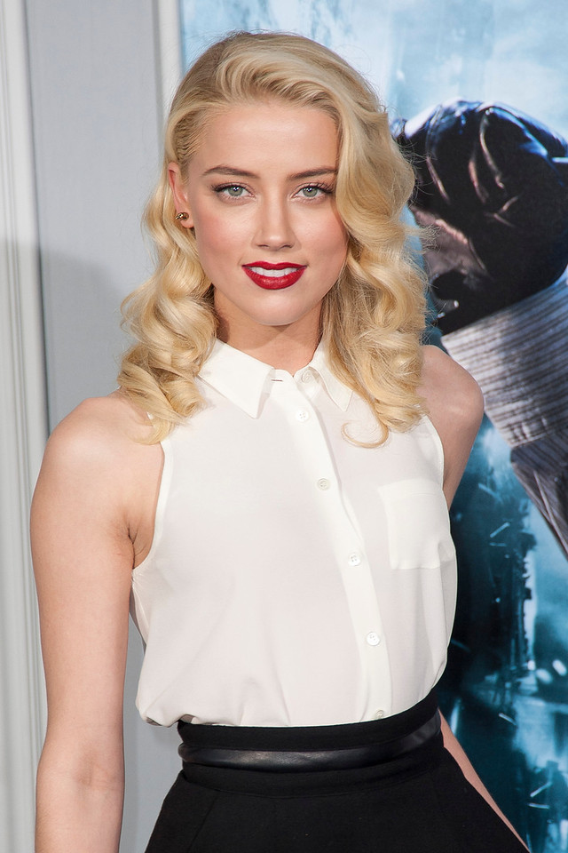 WESTWOOD, CA: Actress Amber Heard arrives at the premiere of Warner Bros. Pictures' 'Sherlock Holmes: A Game Of Shadows' held at the Regency Village Theatre in Westwood, California. Photo taken on Tuesday, December 6, 2011 by Tom Sorensen/Moovieboy Pictures.
