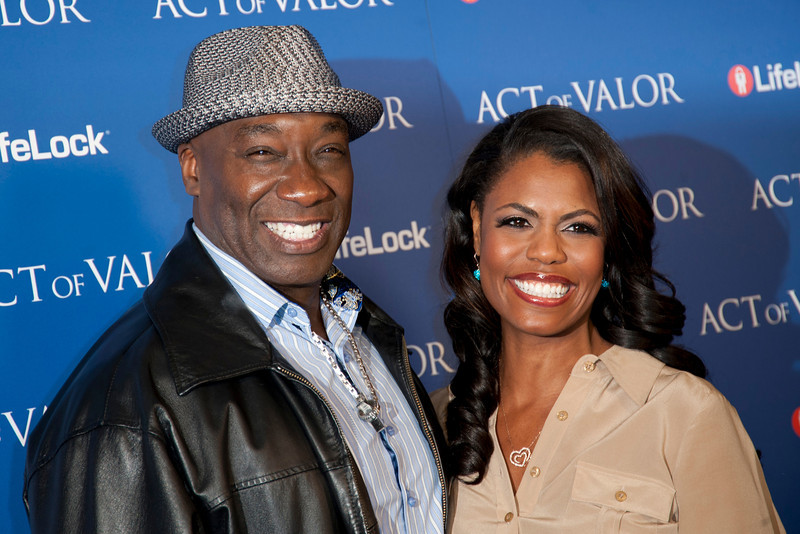 HOLLYWOOD, CA - FEBRUARY 13: Actor Michael Clarke Duncan and TV personality Omarosa Manigault-Stallworth arrive at the premiere of Relativity Media's 'Act Of Valor' held at ArcLight Cinemas on February 13, 2012 in Hollywood, California. Photo taken by Tom Sorensen/Moovieboy Pictures.
