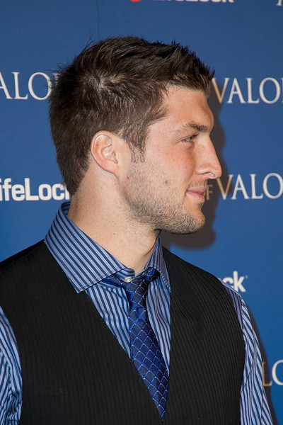 HOLLYWOOD, CA - FEBRUARY 13: NFL Denver Bronco's quarterback Tim Tebow arrives at the premiere of Relativity Media's 'Act Of Valor' held at ArcLight Cinemas on February 13, 2012 in Hollywood, California. Photo taken by Tom Sorensen/Moovieboy Pictures.