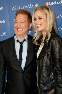 HOLLYWOOD, CA - FEBRUARY 13: Relativity Media CEO Ryan Kavanaugh and his wife Britta Lazenga arrive at the premiere of Relativity Media's 'Act Of Valor' held at ArcLight Cinemas on February 13, 2012 in Hollywood, California. Photo taken by Tom Sorensen/Moovieboy Pictures.