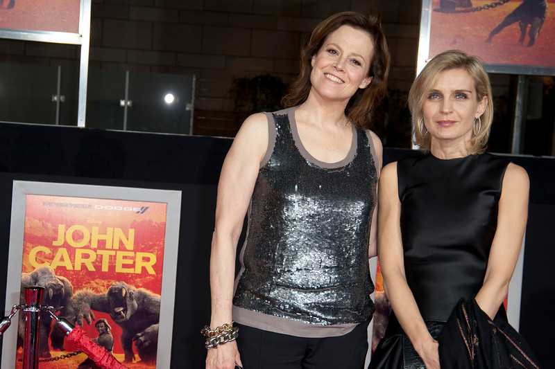 """LOS ANGELES, CA - FEBRUARY 22: Actress Sigourney Weaver (L) and guest arrive at the world premiere of Disney's """"John Carter"""" on Wednesday. February 22, 2012 at Regal Cinemas in downtown Los Angeles. Photo taken by Tom Sorensen/Moovieboy Pictures."""