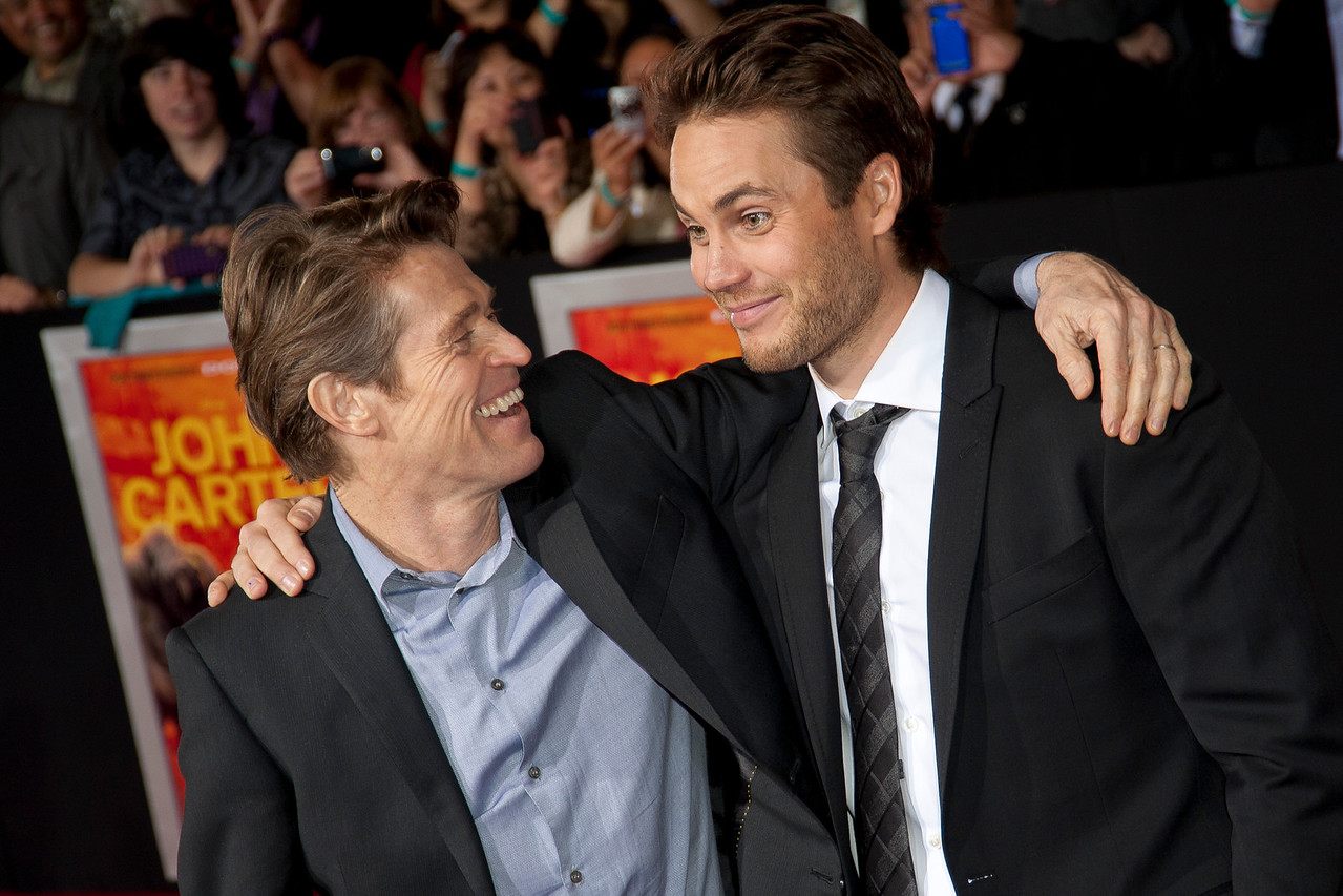 """LOS ANGELES, CA - FEBRUARY 22: Actors Willem Dafoe (L) and Taylor Kitsch arrive at the world premiere of Disney's """"John Carter"""" on Wednesday. February 22, 2012 at Regal Cinemas in downtown Los Angeles. Photo taken by Tom Sorensen/Moovieboy Pictures."""