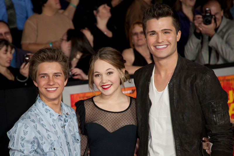 "LOS ANGELES, CA - FEBRUARY 22: Actors Bill Unger (L), Kelli Berglund (C) and Spencer Boldman arrive at the world premiere of Disney's ""John Carter"" on Wednesday. February 22, 2012 at Regal Cinemas in downtown Los Angeles. Photo taken by Tom Sorensen/Moovieboy Pictures."