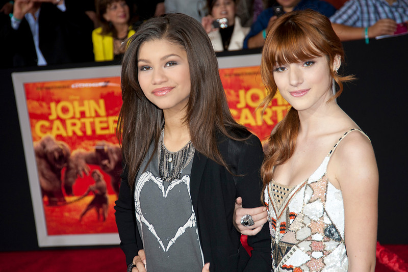 """LOS ANGELES, CA - FEBRUARY 22: Actresses Bella Thorne (R) and Zendaya arrive at the world premiere of Disney's """"John Carter"""" on Wednesday. February 22, 2012 at Regal Cinemas in downtown Los Angeles. Photo taken by Tom Sorensen/Moovieboy Pictures."""