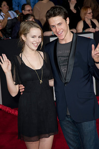 """LOS ANGELES, CA - FEBRUARY 22: Actress Bridgit Mendler and guest arrive at the world premiere of Disney's """"John Carter"""" on Wednesday. February 22, 2012 at Regal Cinemas in downtown Los Angeles. Photo taken by Tom Sorensen/Moovieboy Pictures."""