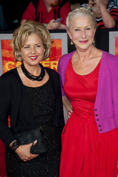 """LOS ANGELES, CA - FEBRUARY 22: Costume designer Mayes C. Rubeo (L) and actress Helen Mirren  arrive at the world premiere of Disney's """"John Carter"""" on Wednesday. February 22, 2012 at Regal Cinemas in downtown Los Angeles. Photo taken by Tom Sorensen/Moovieboy Pictures."""