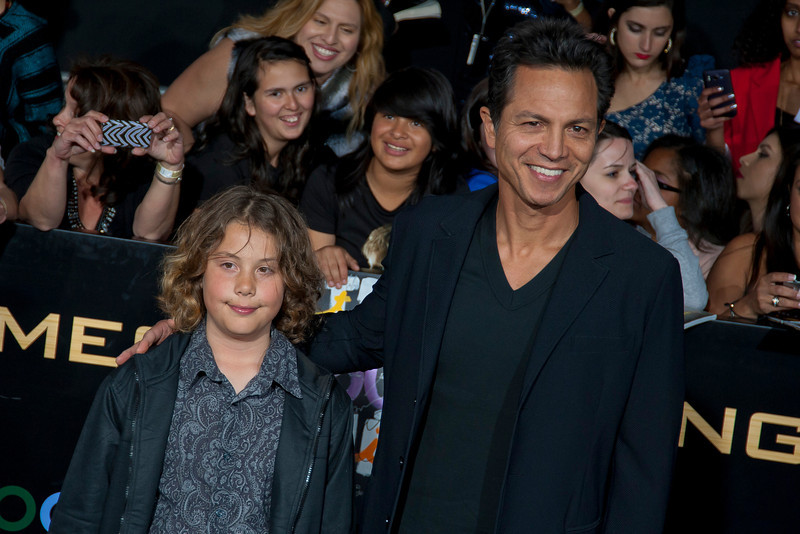 LOS ANGELES, CA - MARCH 12: Mateo Bravery Bratt (L) and actor Benjamin Bratt arrive at the premiere of Lionsgate's 'The Hunger Games' at Nokia Theatre L.A. Live on Monday, March 12, 2012 in Los Angeles, California. Photo taken by Tom Sorensen/Moovieboy Pictures.