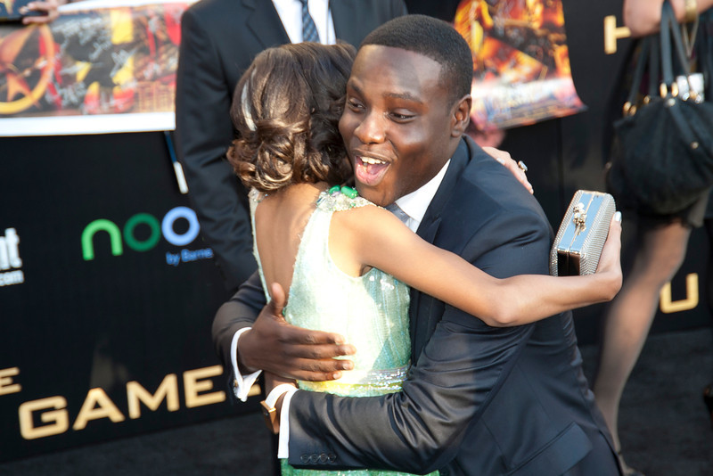 LOS ANGELES, CA - MARCH 12: Actor Dayo Okeniyi and Actress Amandla Stenberg arrive at the premiere of Lionsgate's 'The Hunger Games' at Nokia Theatre L.A. Live on Monday, March 12, 2012 in Los Angeles, California. Photo taken by Tom Sorensen/Moovieboy Pictures.