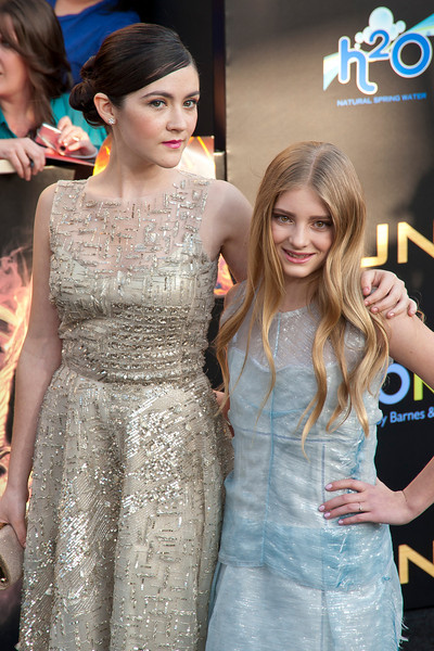 LOS ANGELES, CA - MARCH 12: Actresses Isabelle Fuhrman and Willow Shields arrive at the premiere of Lionsgate's 'The Hunger Games' at Nokia Theatre L.A. Live on Monday, March 12, 2012 in Los Angeles, California. Photo taken by Tom Sorensen/Moovieboy Pictures.