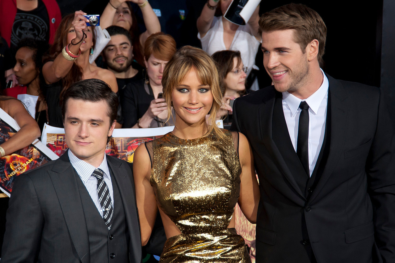 LOS ANGELES, CA - MARCH 12: Actors Josh Hutcherson, Jennifer Lawrence, and Liam Hemsworth arrive at the premiere of Lionsgate's 'The Hunger Games' at Nokia Theatre L.A. Live on Monday, March 12, 2012 in Los Angeles, California. Photo taken by Tom Sorensen/Moovieboy Pictures.
