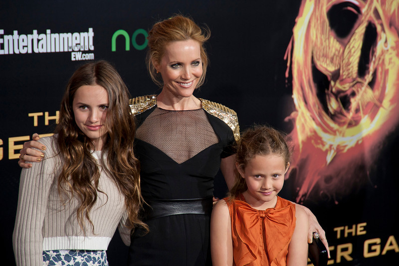LOS ANGELES, CA - MARCH 12: Actress Leslie Mann (C) and family arrive at the premiere of Lionsgate's 'The Hunger Games' at Nokia Theatre L.A. Live on Monday, March 12, 2012 in Los Angeles, California. Photo taken by Tom Sorensen/Moovieboy Pictures.