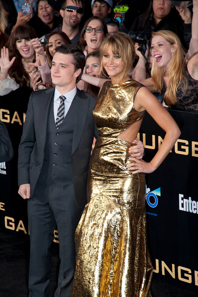LOS ANGELES, CA - MARCH 12: Actors Josh Hutcherson and Jennifer Lawrence arrive at the premiere of Lionsgate's 'The Hunger Games' at Nokia Theatre L.A. Live on Monday, March 12, 2012 in Los Angeles, California. Photo taken by Tom Sorensen/Moovieboy Pictures.