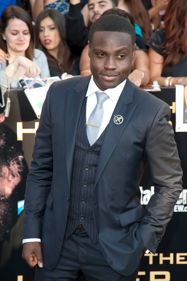 LOS ANGELES, CA - MARCH 12: Actor Dayo Okeniyi arrives at the premiere of Lionsgate's 'The Hunger Games' at Nokia Theatre L.A. Live on Monday, March 12, 2012 in Los Angeles, California. Photo taken by Tom Sorensen/Moovieboy Pictures.