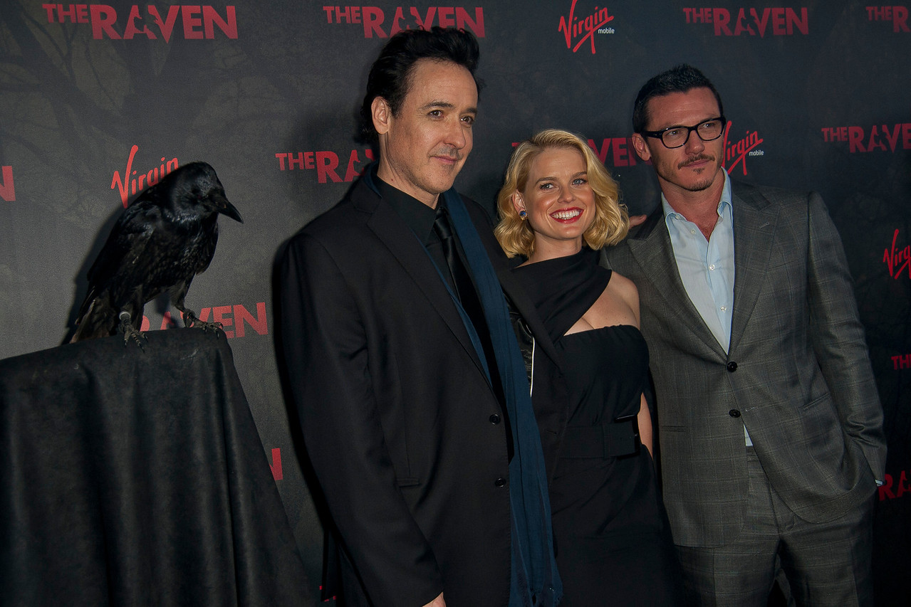 LOS ANGELES, CA - APRIL 23: (L-R) Actors John Cusack, Alice Eve and Luke Evans arrive at the Los Angeles premiere of Relativity Media's 'The Raven' held at the Los Angeles Theatre on April 23, 2012 in Los Angeles, California. Photo taken by Tom Sorensen/Moovieboy Pictures.