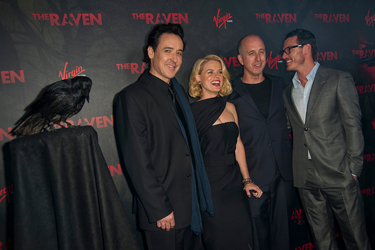 LOS ANGELES, CA - APRIL 23: (L-R) Actors John Cusack, Alice Eve, director James McTeigue and Luke Evans arrive at the Los Angeles premiere of Relativity Media's 'The Raven' held at the Los Angeles Theatre on April 23, 2012 in Los Angeles, California. Photo taken by Tom Sorensen/Moovieboy Pictures.