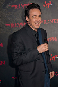 LOS ANGELES, CA - APRIL 23: Actor John Cusack arrives at the Los Angeles premiere of Relativity Media's 'The Raven' held at the Los Angeles Theatre on April 23, 2012 in Los Angeles, California. Photo taken by Tom Sorensen/Moovieboy Pictures.