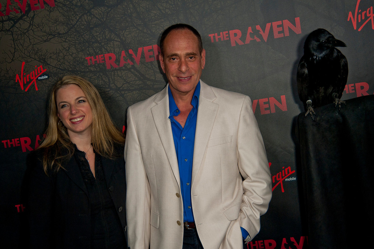 LOS ANGELES, CA - APRIL 23: Actor Nestor Serrano (R) and wife Debbie Serrano attend at the Los Angeles premiere of Relativity Media's 'The Raven' held at the Los Angeles Theatre on April 23, 2012 in Los Angeles, California. Photo taken by Tom Sorensen/Moovieboy Pictures.
