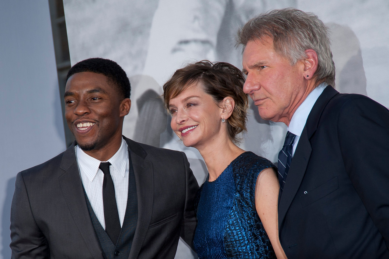 HOLLYWOOD, CA - APRIL 09: Actor Chadwick Boseman, actress Calista Flockhart and actor Harrison Ford attend the Los Angeles Premiere of Warner Bros. Pictures' and Legendary Pictures' '42' at TCL Chinese Theatre on Tuesday, April 9, 2013 in Hollywood, California. (Photo by Tom Sorensen/Moovieboy Pictures)
