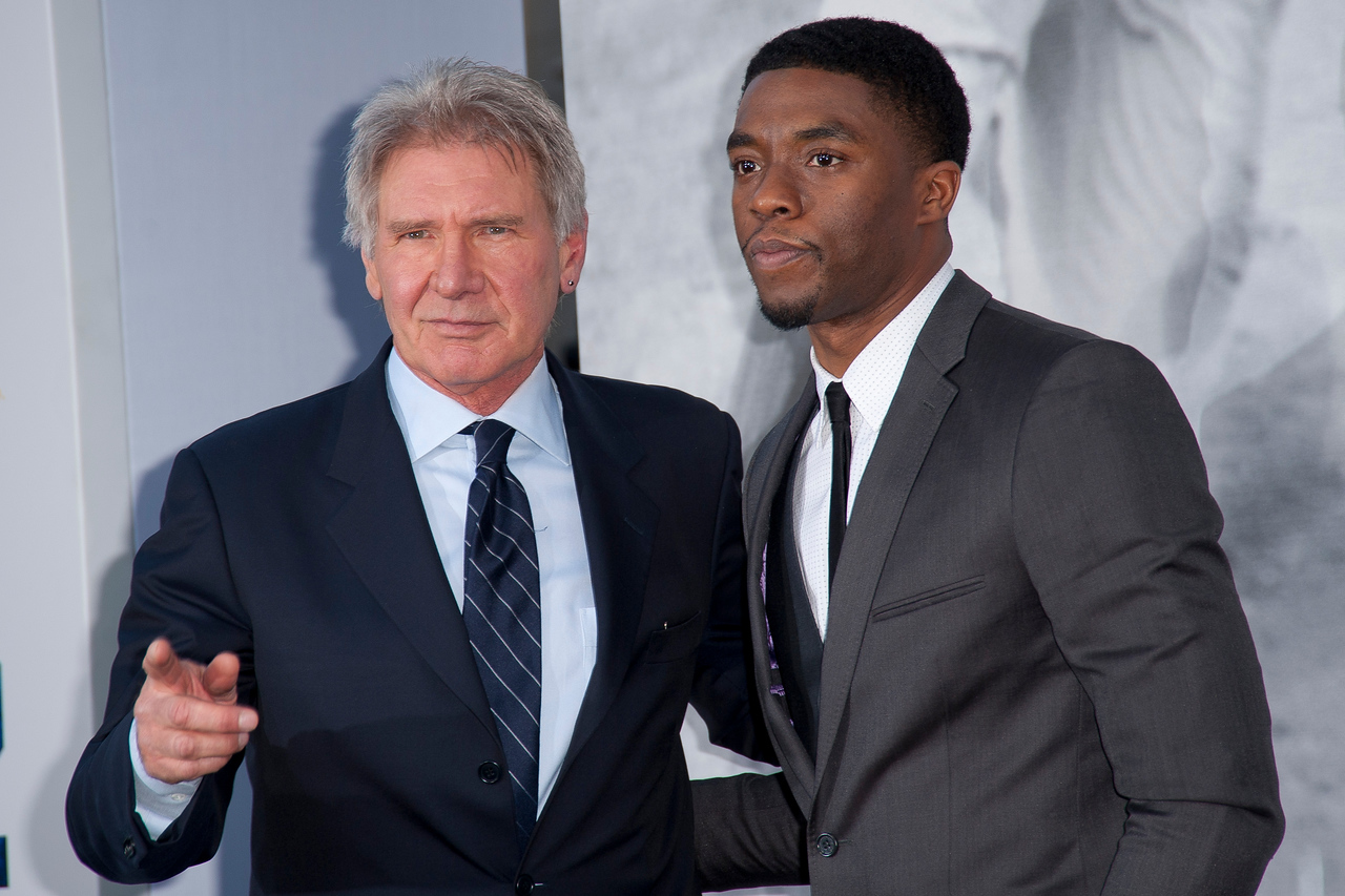 HOLLYWOOD, CA - APRIL 09: Actors Harrison Ford and Chadwick Boseman attend the Los Angeles Premiere of Warner Bros. Pictures' and Legendary Pictures' '42' at TCL Chinese Theatre on Tuesday, April 9, 2013 in Hollywood, California. (Photo by Tom Sorensen/Moovieboy Pictures)