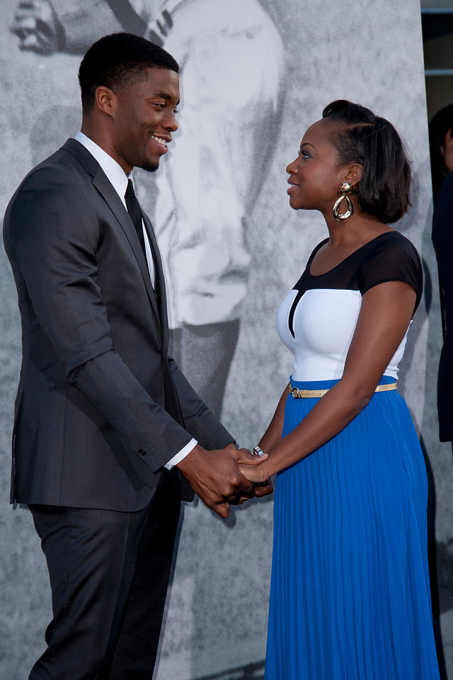 HOLLYWOOD, CA - APRIL 09: Actors Chadwick Boseman and Naturi Naughton attend the Los Angeles Premiere of Warner Bros. Pictures' and Legendary Pictures' '42' at TCL Chinese Theatre on Tuesday, April 9, 2013 in Hollywood, California. (Photo by Tom Sorensen/Moovieboy Pictures)