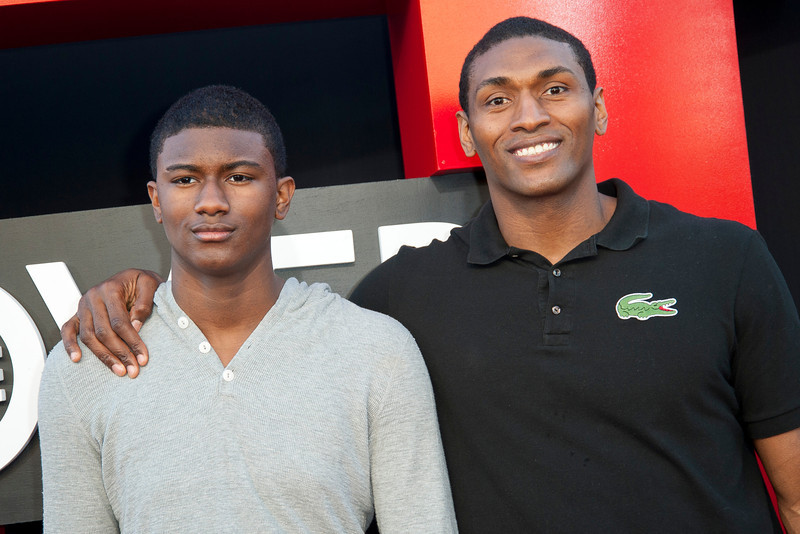 WESTWOOD, CA - MAY 20: Pro basketball player Metta World Peace (R) and son attend the premiere of Warner Bros. Pictures' 'Hangover Part 3' at Westwood Village Theater on Monday, May 20, 2013 in Westwood, California. (Photo by Tom Sorensen/Moovieboy Pictures)