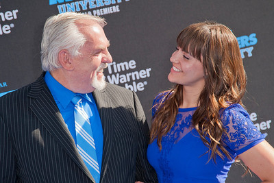 HOLLYWOOD, CA - JUNE 17: Actor John Ratzenberger (L) and Nina Ratzenberger attend the world premiere of Disney Pixar's 'Monsters University' at the El Capitan Theatre on Monday, June 17, 2013 in Hollywood, California. (Photo by Tom Sorensen/Moovieboy Pictures)
