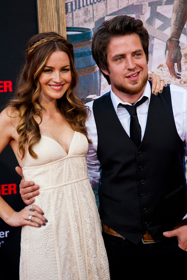 ANAHEIM, CA - JUNE 22: Singer Lee DeWyze (R) and actress/wife Jonna Walsh attend the premiere of Walt Disney Pictures' 'The Lone Ranger' at Disney California Adventure Park on Saturday, June 22, 2013 in Anaheim, California. (Photo by Tom Sorensen/Moovieboy Pictures)