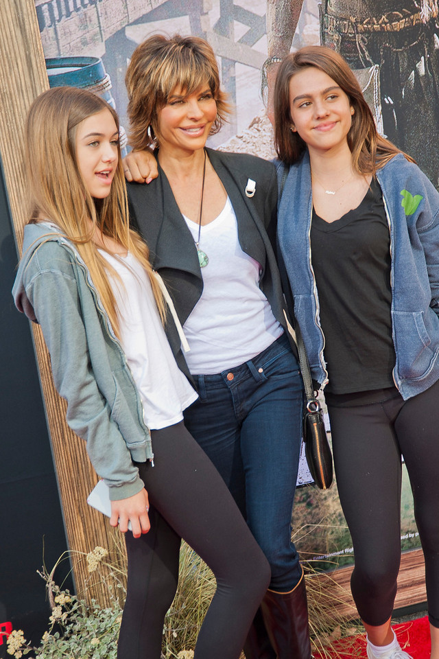 ANAHEIM, CA - JUNE 22: Actress Lisa Rinna (C), daughters Delilah Hamlin and Amelia Hamlin attend the premiere of Walt Disney Pictures' 'The Lone Ranger' at Disney California Adventure Park on Saturday, June 22, 2013 in Anaheim, California. (Photo by Tom Sorensen/Moovieboy Pictures)