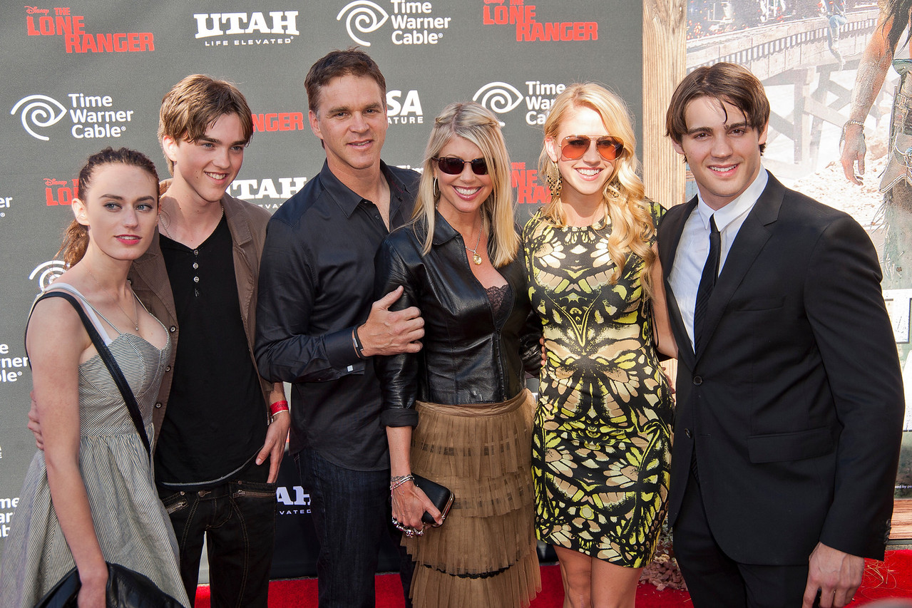 ANAHEIM, CA - JUNE 22: Former NHL player and L.A. Kings President, Business Operations Luc Robitaille (3rd from L), actress/wife Stacey Toten (4th from L), actor Steven R. McQueen (R) and guests attend the premiere of Walt Disney Pictures' 'The Lone Ranger' at Disney California Adventure Park on Saturday, June 22, 2013 in Anaheim, California. (Photo by Tom Sorensen/Moovieboy Pictures)