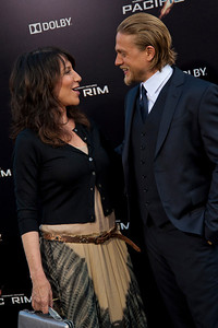 HOLLYWOOD, CA - JULY 09: Actors Katey Sagal (L) and Charlie Hunnam arrive at the premiere of Warner Bros. Pictures' and Legendary Pictures' 'Pacific Rim' at Dolby Theatre on Tuesday, July 9, 2013 in Hollywood, California. (Photo by Tom Sorensen/Moovieboy Pictures)